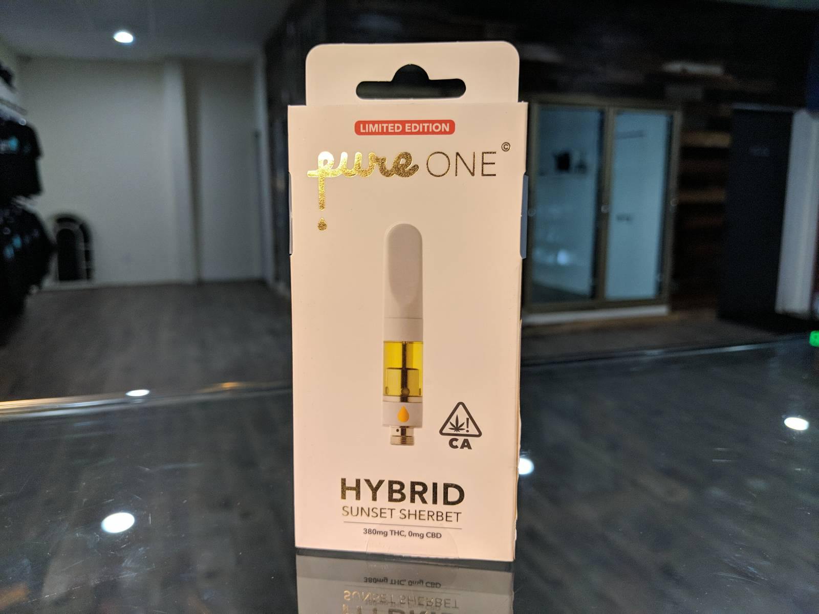 Pure one half gram sunset sherbet hybrid cartridge